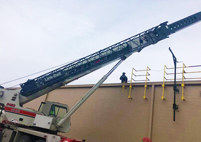 Commercial job being accomplished with a crane.